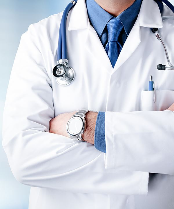 Photo of a man with a white lab coat and stethoscope