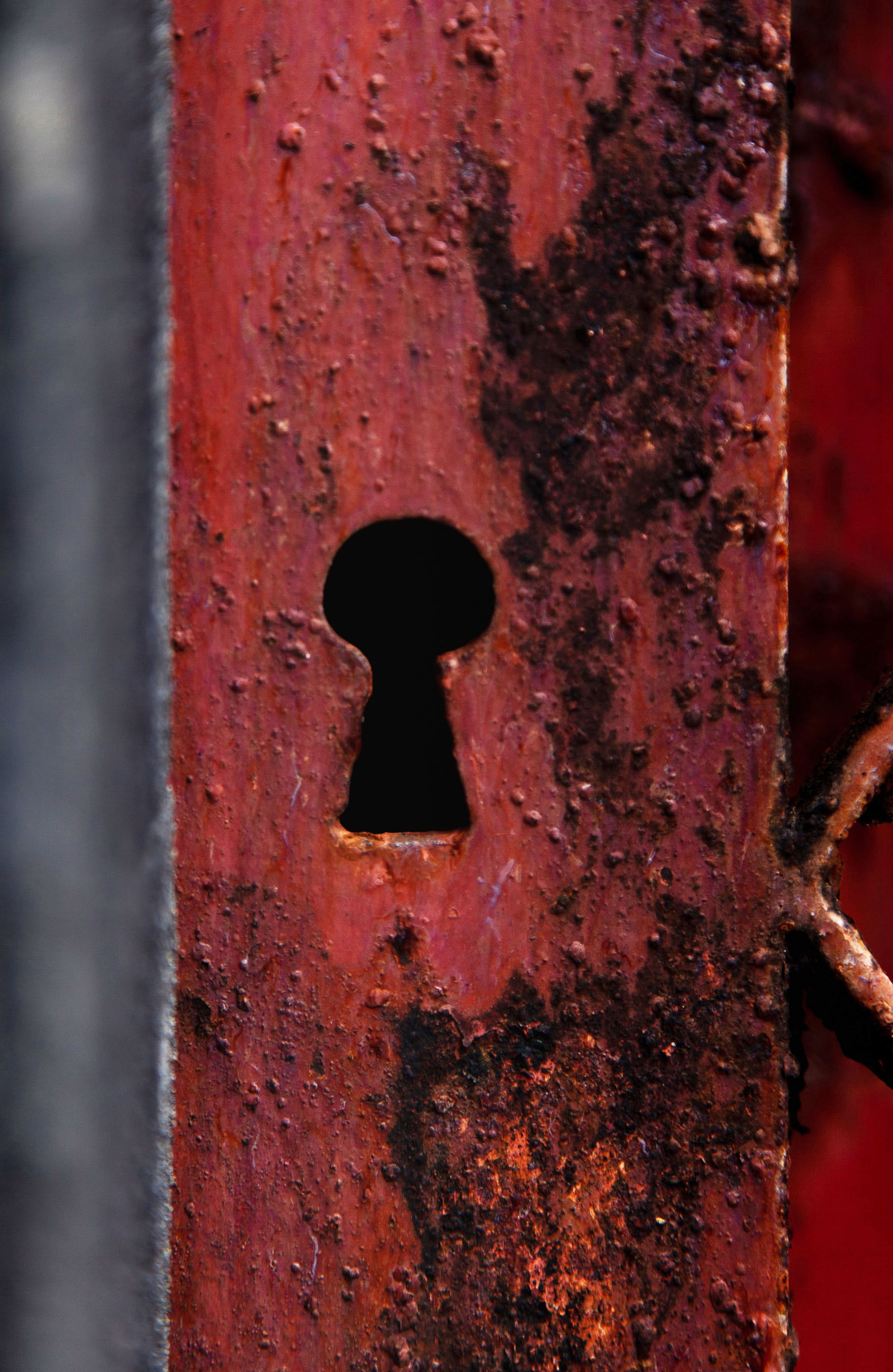 Red Rusty metal door keyhole