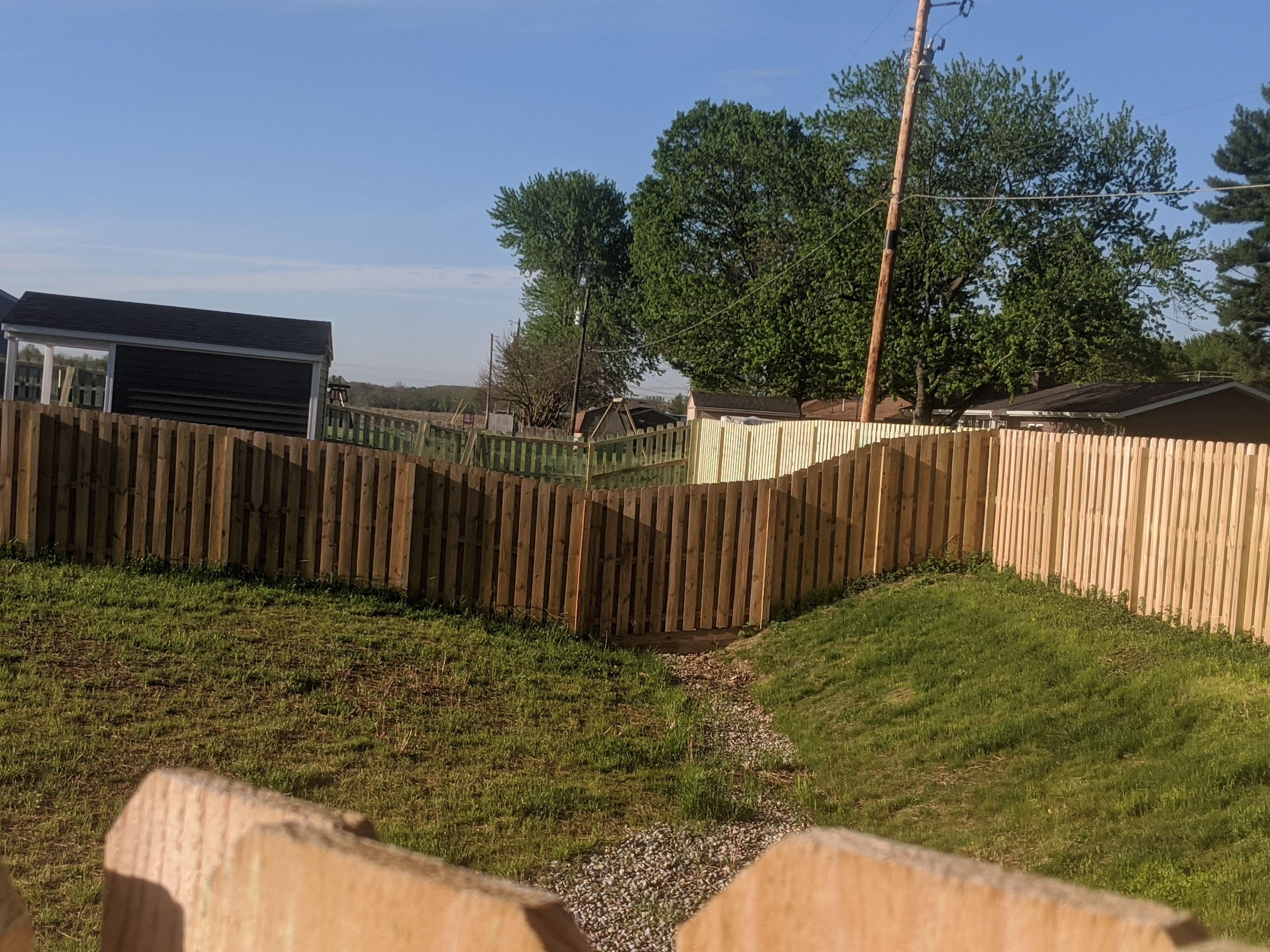 A fence built across a drainage easement blocks the flow and creates flooding